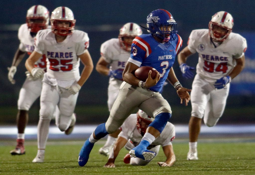 Duncanville quarterback Ja'Quinden Jackson (3) cuts as he rambles through the Richardson Pearce secondary as he attracts a host of defenders in pursuit enroute to his 81-yard rushing touchdown during the second quarter of play. The score was Jackson's second rushing touchdown of the first half. The two teams played their District 8-6A football game at Duncanville High School's Panther Stadium on October 19, 2018. (Steve Hamm/ Special Contributor)