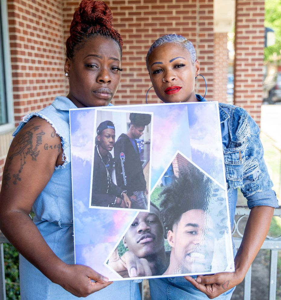 Kurtrice Coleman, left, and Nikki Beck, right,  pose with a photograph of their sons, Gregory Horton and Zacchaeus Banks at The Rose Community Center in Dallas on Sept. 5