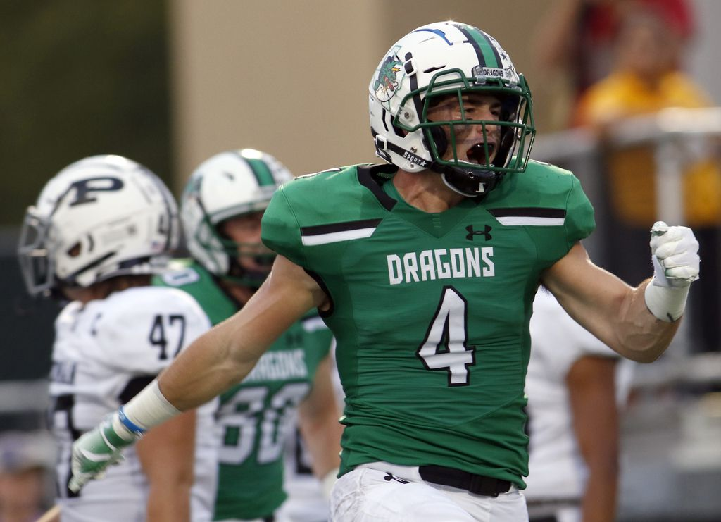 Southlake Carroll running back T.J. McDaniel (4) lets out a yell after igniting a capacity home crowd following his 56-yard rushing touchdown to break a scoreless tie in the first quarter of their game against Odessa Permian.The two teams played their non-district  football game at Southlake Carroll's Dragon Stadium in Southlake on September 14, 2018.  (Steve Hamm/ Special Contributor)
