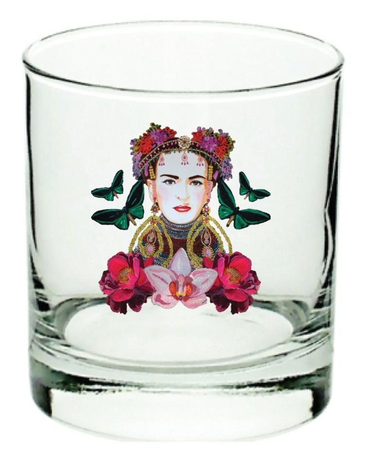 """""""Frida"""" glass designed by Ashley Longshore for Forty Five Ten in Dallas. The glass is part of collection of four (including Grace Kelly and Audrey Hepburn) that sells for $125.  Artist Ashley Longshore, known for the wit and humor of her designs and frequent fashion collaborations, has created an exclusive new collection for Forty Five Ten's home collection in Dallas"""