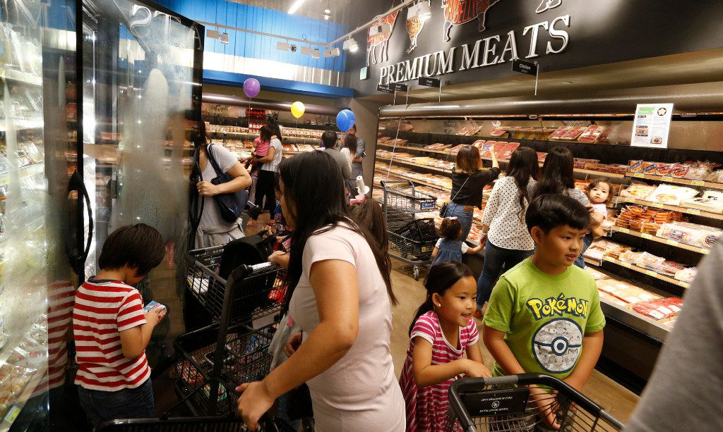 People shop around the butchers section during the grand opening of the Mitsuwa Market place in Plano, Texas on April 14, 2017. (Nathan Hunsinger/The Dallas Morning News)