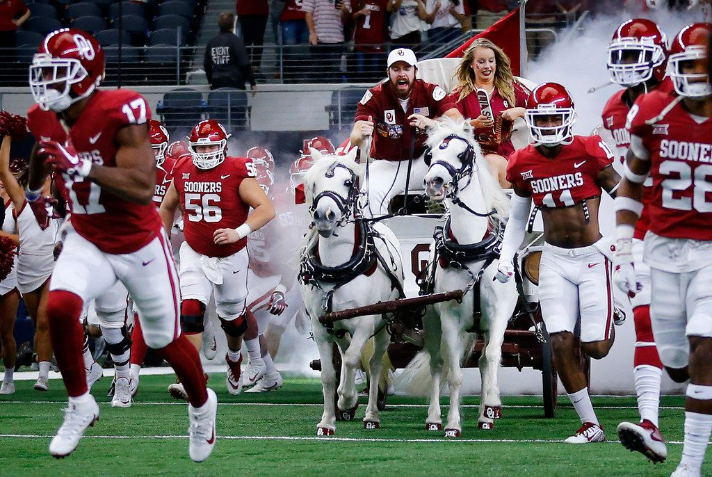 The Sooner Schooner leads the Oklahoma Sooners football team onto the field to face the TCU Horned Frogs in the Big XII Championship game at AT&T Stadium in Arlington, Texas, Saturday, December 2, 2017. (Tom Fox/The Dallas Morning News)
