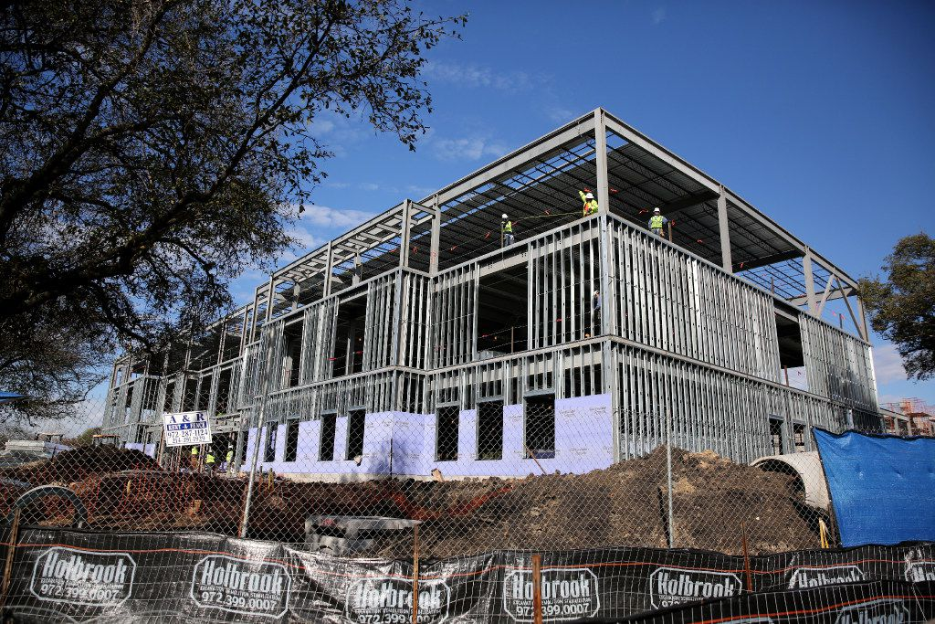 Workers construct Highland Park ISD's fifth elementary school along Durham Street in Dallas on Wednesday, Jan. 25, 2017.