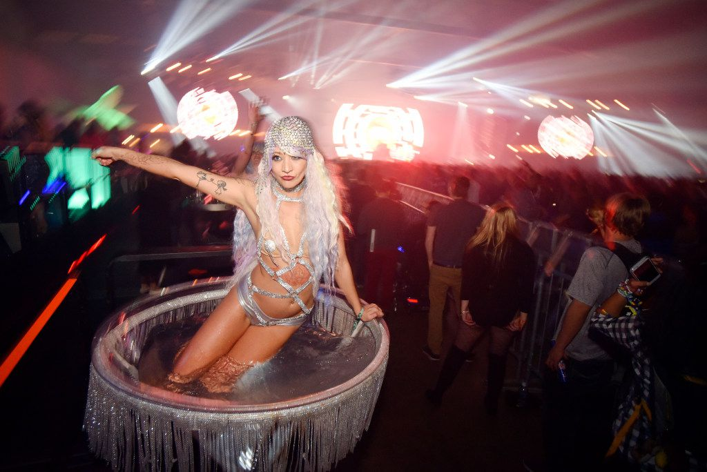 Dancer Danielle Bennett, 26, of a Houston entertainment group, dances in a large martini glass during the electronic dance music festival Lights All Night at Dallas Market Hall, on Dec. 31, 2016 in Dallas. The event hosted neon costumes, professional dancers, and electronic dance DJs from around the world. Ben Torres/Special Contributor