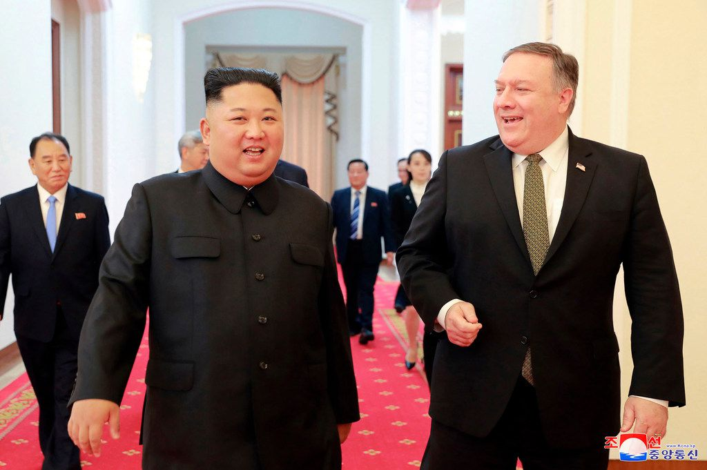 "In this Oct. 7, 2018, photo provided by the North Korean government, North Korean leader Kim Jong Un, center left, and U.S. Secretary of State Mike Pompeo walk together before their meeting in Pyongyang, North Korea. Pompeo said that he and Kim made unspecified progress toward an agreement for the North to give up its nuclear weapons, though there was no immediate indication whether Pompeo had managed to arrange a much-anticipated second summit between Kim and President Donald Trump. Independent journalists were not given access to cover the event depicted in this image distributed by the North Korean government. The content of this image is as provided and cannot be independently verified. Korean language watermark on image as provided by source reads: ""KCNA"" which is the abbreviation for Korean Central News Agency."