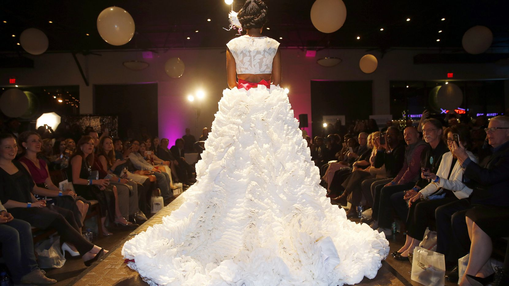 Model Rosie Lawrence models a dress made of coffee filters which was designed by Angel Burrell under the label Tru'anjl during the Food in Fashion event at 3015 in the Trinity Groves area of Dallas.