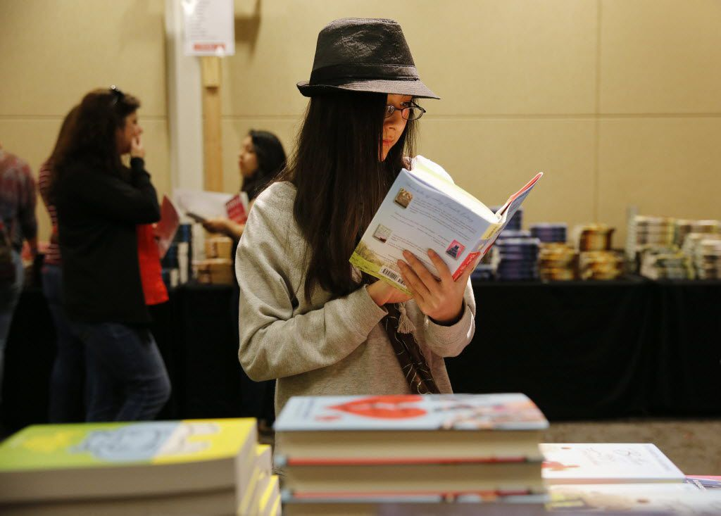 Daja Shelton, 13, of Granbury, checked out a book during the inaugural North Texas Teen Book Festival in 2015. (File Photo/Andy Jacobsohn)