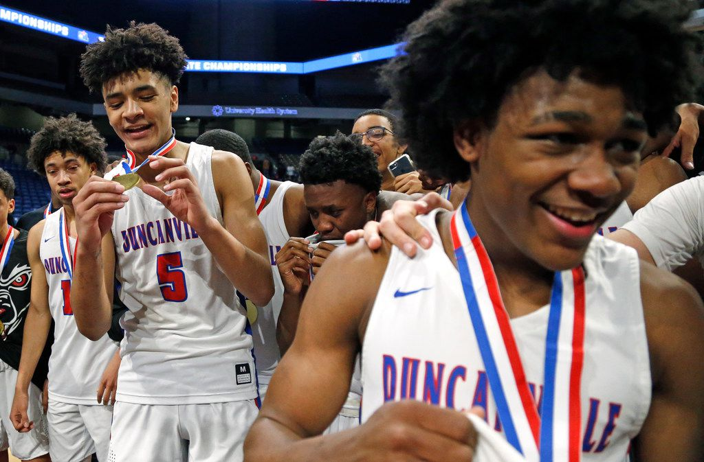 Duncanville's Micah Peavy #5 checks out his medal while Duncanville's Ja'Bryant Hill #2 celebrates on the right. UIL boys basketball 6A State Final between Duncanville v Klein Forest on Saturday March 9, 2019 at the Alamodome in San Antonio, Texas. (Ron Cortes/ Special Contributor)
