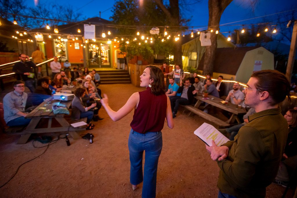 Playwrights Janielle Kastner and Brigham Mosley interact with the audience at The Wild Detectives as they present portions of a play they wrote about their experience at The Dallas Morning News.