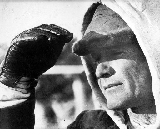 Dallas Cowboys coach Tom Landry shades his eyes against glare in waning minutes of championship against the Green Bay Packers in the 1967 Ice Bowl game.
