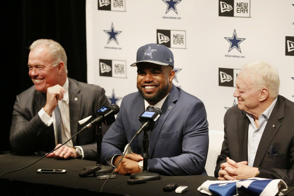 Running back Ezekiel Elliott (center), who played for Ohio State, is introduced by Dallas Cowboys executive vice president Stephen Jones (left) and owner Jerry Jones after being drafted fourth overall in the 2016 NFL draft by the Cowboys at the team's headquarters in Irving, Texas, Friday April 29, 2016. (Andy Jacobsohn/The Dallas Morning News)