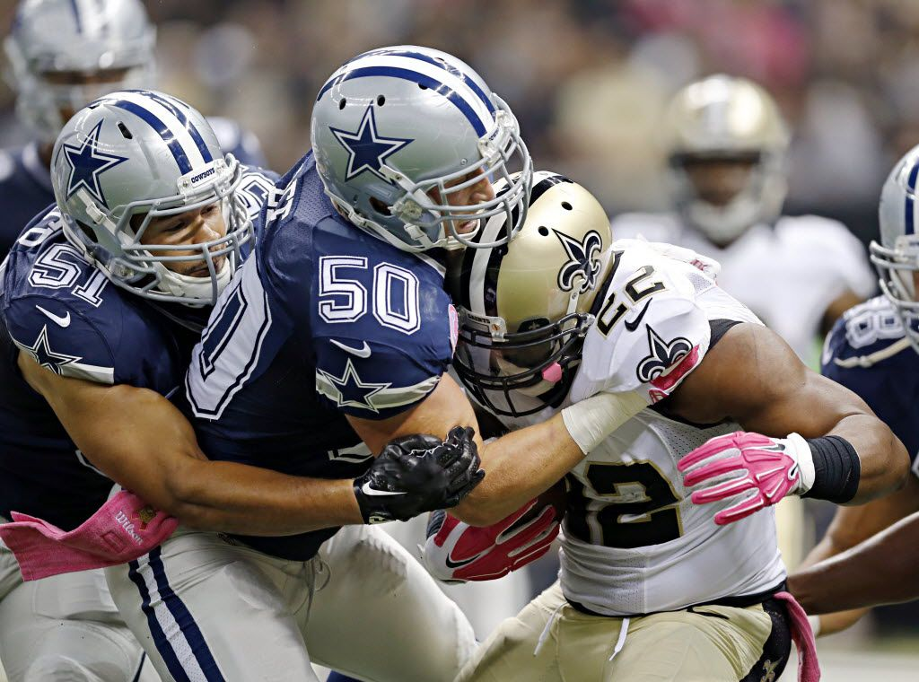 Dallas Cowboys outside linebacker Sean Lee (50) and outside linebacker Kyle Wilber work to tackle New Orleans Saints running back Mark Ingram during the first half of their game Sunday, October 4, 2015 at the Mercedes-Benz Superdome in New Orleans, La. (G.J. McCarthy/The Dallas Morning News)