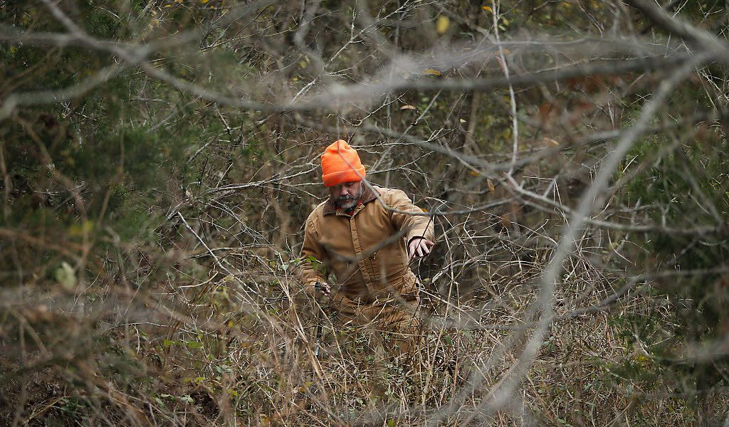 Robert O'Neil, one of the coordinators for the dedicated group of searchers known as Team Christina, made his way through thick brush in December 2016 in northern Collin County.