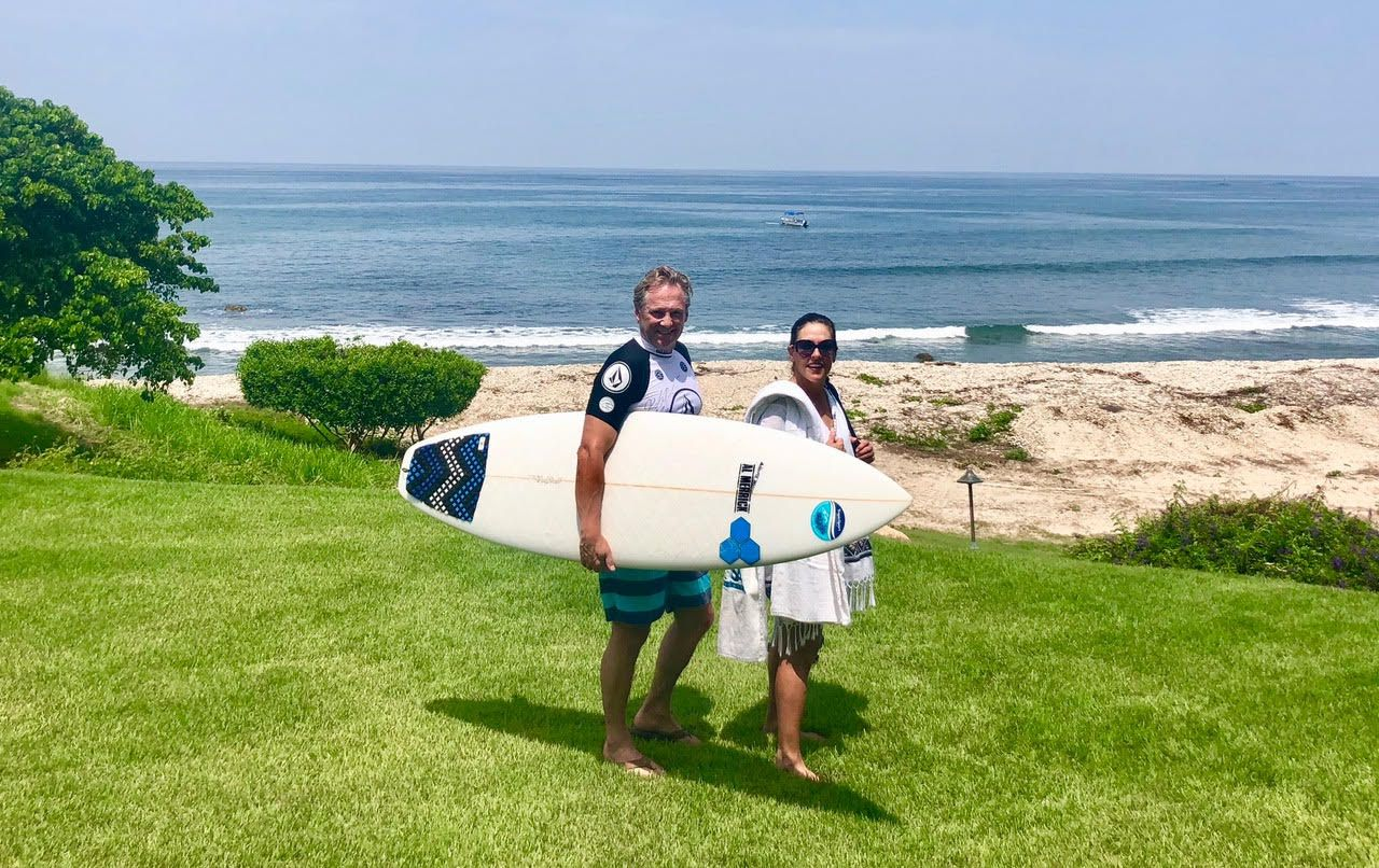 Australian native Tony Palmer (left) grew up surfing in Queensland. He and his wife, Lisa Palmer, started a sunscreen company to develop a safer, more natural alternative to chemical sunscreens.