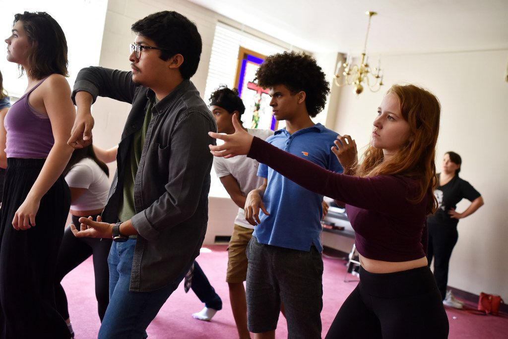 Ollin Barraza Fernandez, 18, left, Landon Robinson, 15, and Angie Hogue, 17, right, rehearse Cry Havoc Theater Company's Crossing the Line.