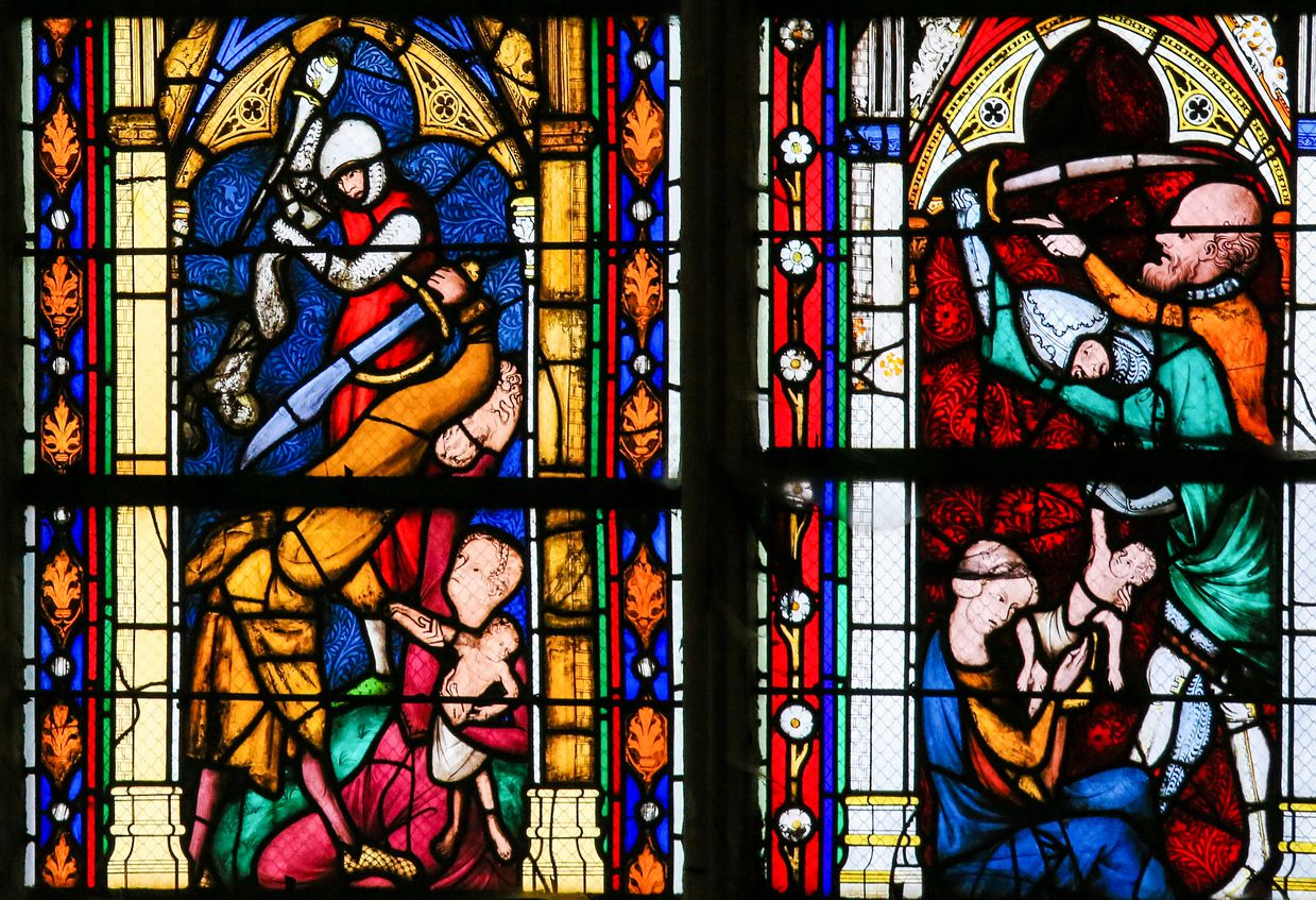 The Massacre of the Innocents, the biblical recount of infanticide by Herod the Great, on a stained glass in the cathedral of Rouen.
