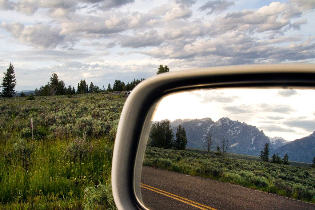 The Teton Range reflected in the rear-view mirror during a road trip through Wyoming, June 16, 2015. (Janie Osborne/The New York Times)
