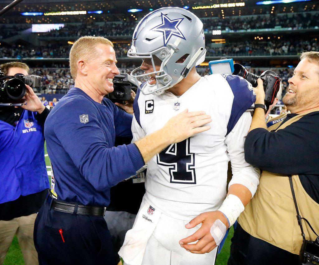 Dallas Cowboys head coach Jason Garrett congratulates quarterback Dak Prescott (4) on the 13-10 win over the New Orleans Saints at AT&T Stadium in Arlington, Texas, Thursday, November 29, 2018. (Tom Fox/The Dallas Morning News)