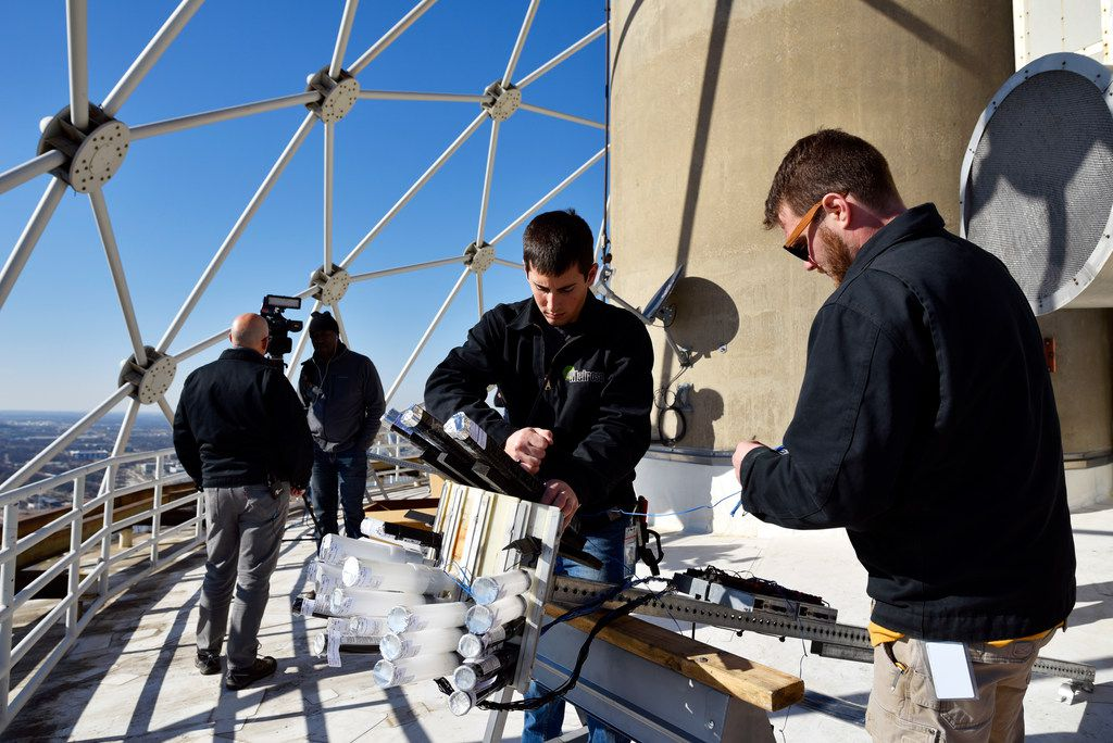 Pyrotechnicians Mike Cartolano, left, and Nick Pravecek, of Melrose Pyrotechnics, install fireworks on a Reunion Tower roof for this year's New Years Eve celebration, Dec. 28, 2018. The Chicago based company has been working the New Years Eve show for the past five years.