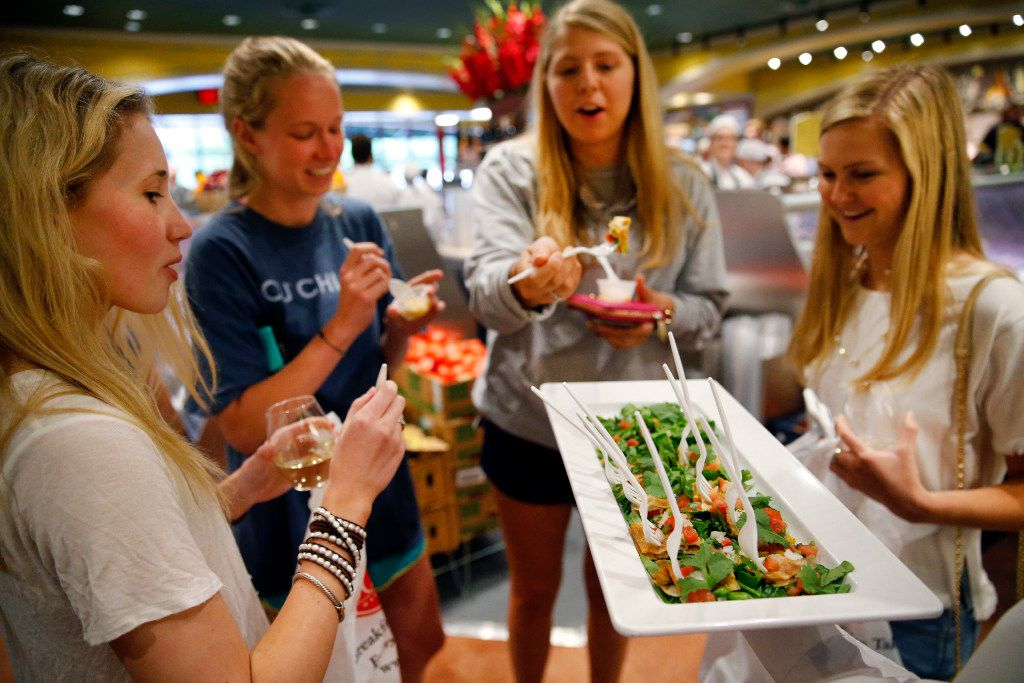 A group of girls try quesadilla appetizers during VIP night at the new Eatzi's Market & Bakery at University Park Village in Fort Worth.