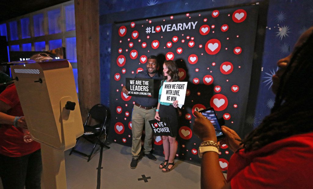 Queavis and Jacklyn Napier pose for a photo at a photo booth at the We Rise tour to fight hatred and racism, at the House of Blues in Dallas on Aug. 18, 2017.