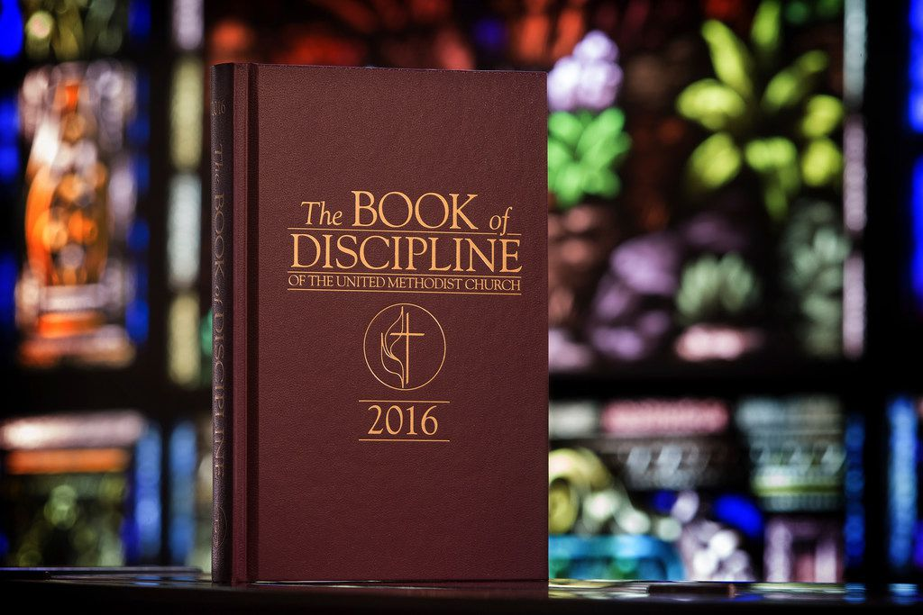 This 2017 photo provided by the United Methodist News Service shows the Book of Discipline which contains the rules that guide the United Methodist Church.