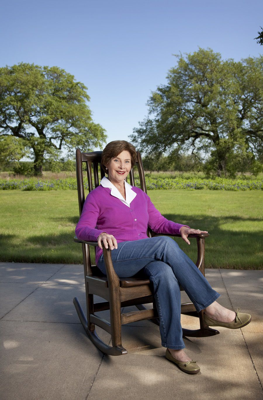Former First Lady Laura Bush photographed on April 26, 2010, at the ranch in Crawford, Texas. She is seated in a rocking chair that was part of a custom made pair given to the President and First Lady by senior staff on their last Christmas in office. The wood for the chairs is from their ranch.