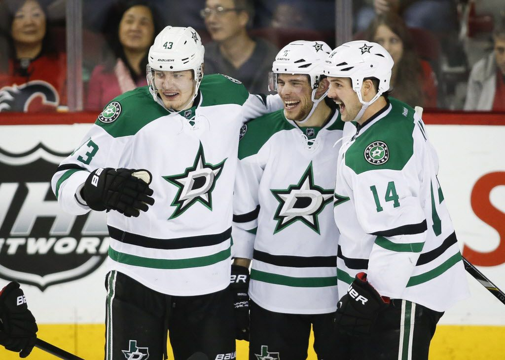 Dallas Stars' Tyler Seguin, centre, celebrates his goal with teamates Valeri Nichushkin, left, from Russia, and Jamie Benn during third period NHL hockey action against the Calgary Flames in Calgary, Alta., Thursday, Nov. 14, 2013. The Dallas Stars beat the Calgary Flames 7-3. (AP Photo/The Canadian Press, Jeff McIntosh) 11172013xSPORTS