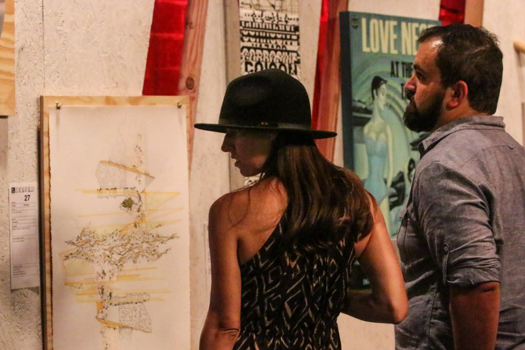 Attendees preview the art before the live auction at Art Con Skewed at Life in Deep Ellum on June 6, 2015