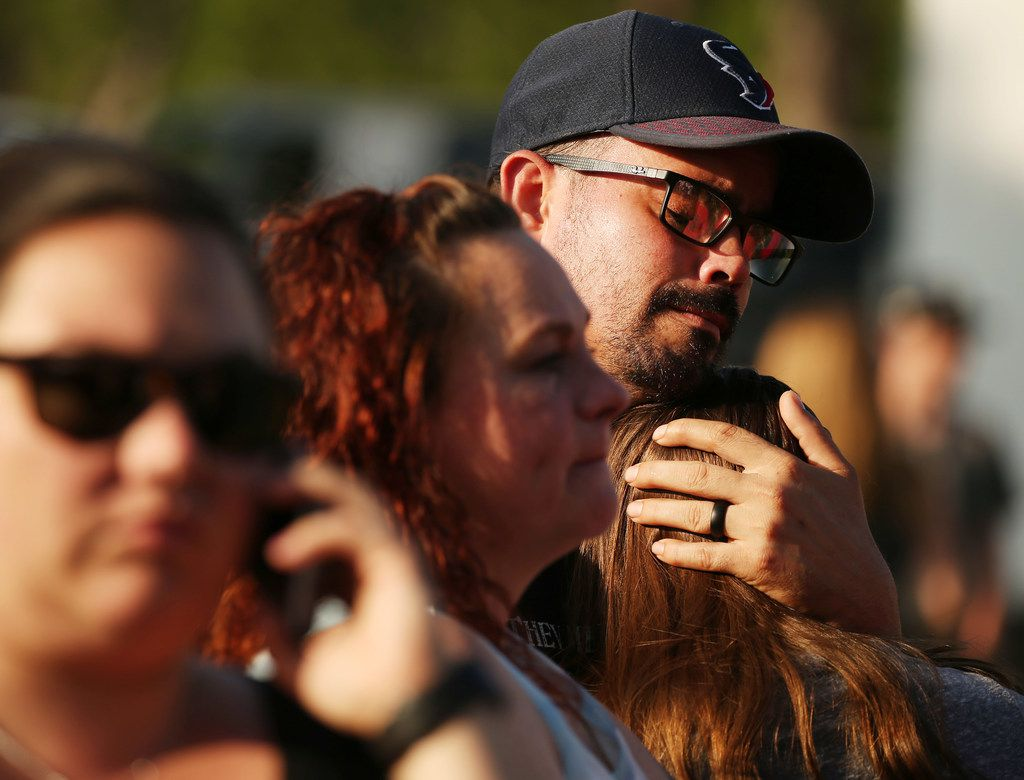 William Hunter embraces his daughter Destiny Hunter, who is home schooled, during a vigil following a shooting at Santa Fe High School on May 18.
