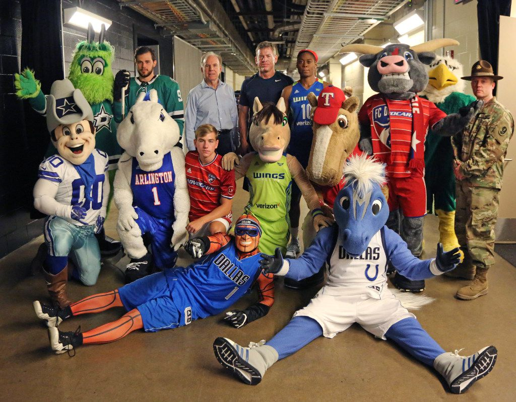 Roger Staubach and Troy Aikman posed with local sports figures and mascots after filming a public service announcement for United Way of Metropolitan Dallas at American Airlines Center on  Aug. 7.