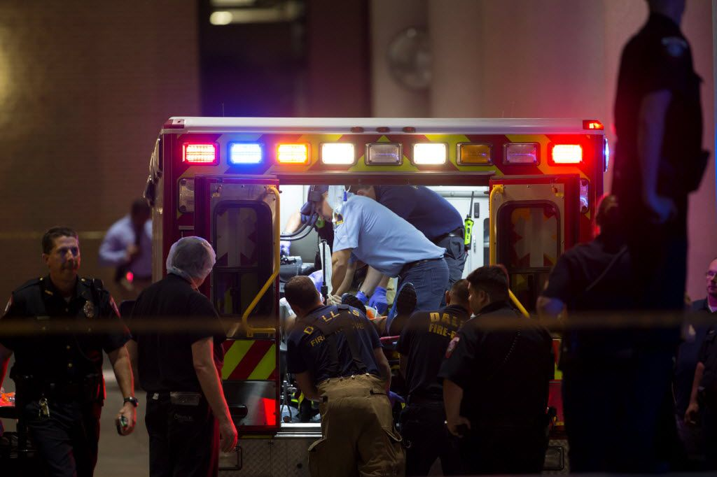 Dallas Fire Department EMT personnel administers CPR to a patient on the ambulance right after arriving at Baylor Hospital Emergency Room on July 8, 2016 in Dallas, Texas. 11 Police officers shot, 4 dead, 1 person in custody after shots fired during downtown Dallas Black Lives Matters rally Thursday night. (Ting Shen/The Dallas Morning News)