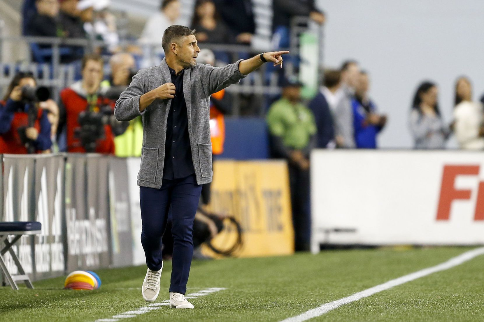 FC Dallas Head Coach Luchi Gonzalez shows off a sweater look at the Seattle Sounders. (9-18-19)