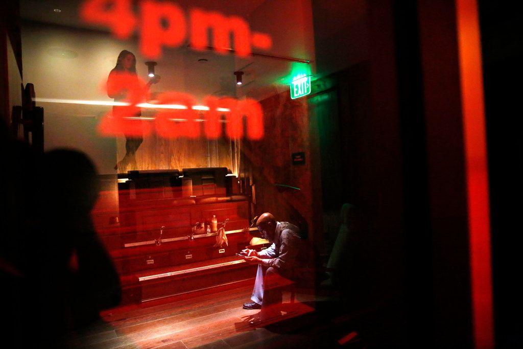 Mark Ayers sits at his shoe shine station at Bourbon & Banter speakeasy inside The Statler Hotel.
