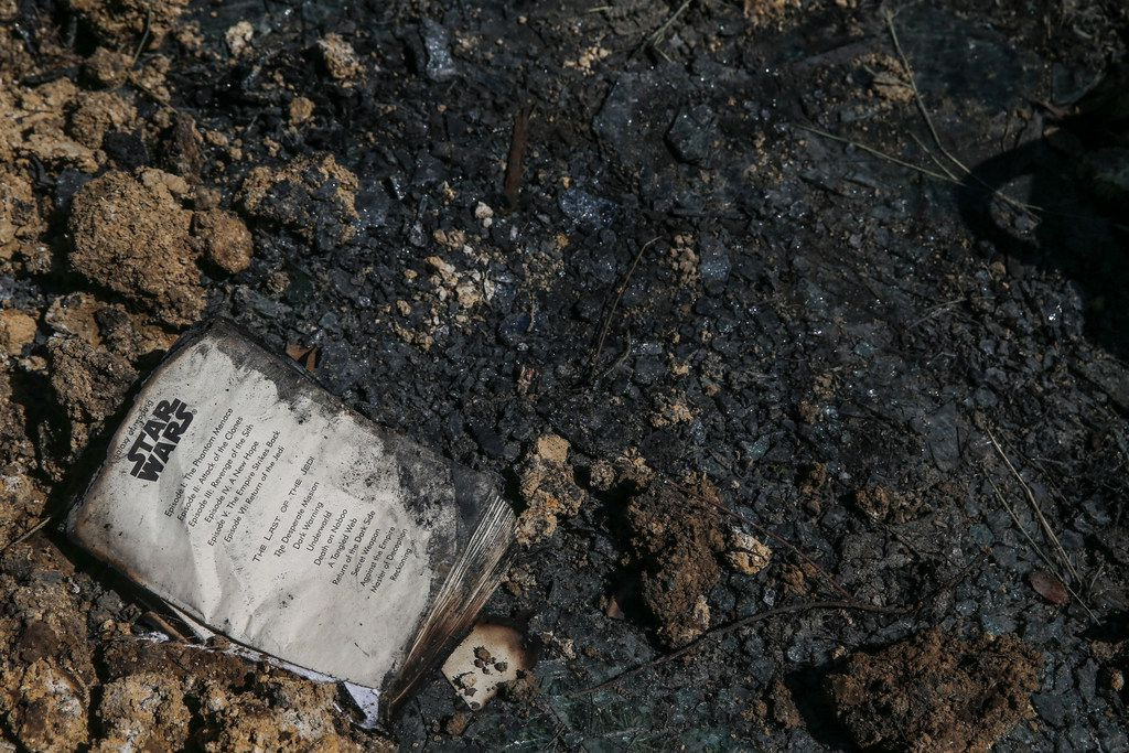 A book lies in the rubble at the site of a memorial where one student died Wednesday when a Mesquite ISD school bus rolled into a ditch with 40 students on board in the 3500 block of Lawson Road on Thursday, Oct. 4, 2018 in Mesquite, Texas. (Ryan Michalesko/The Dallas Morning News)