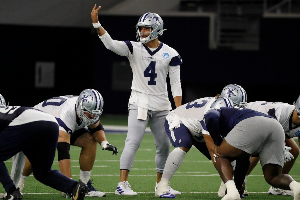 Dallas Cowboys quarterback Dak Prescott (4) signals at the line of scrimmage as the team works out at their NFL football training facility in Frisco, Texas, Thursday, June 13, 2019. (AP Photo/Tony Gutierrez