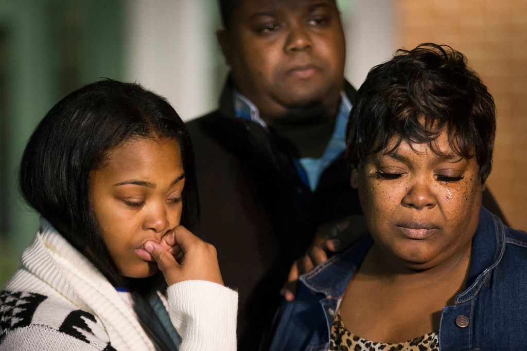 A tear rolls down the cheek of Jacqueline Craig (right) as she attends a press conference with her 15-year old daughter (left) and cousin Rod Smith outside Fort Worth Police Department's Bob Bolen Public Safety Complex on Thursday.