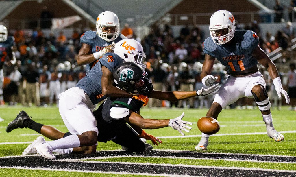Lancaster defensive back Lorando Johnson (13) prevents a catch near the end zone by Mansfield Lake Ridge wide receiver TJ Graham (6) during the first quarter of a high school football game between Lancaster and Mansfield Lake Ridge on Friday, September 22, 2017 at Vernon Newsom Stadium in Mansfield, Texas. (Ashley Landis/The Dallas Morning News)