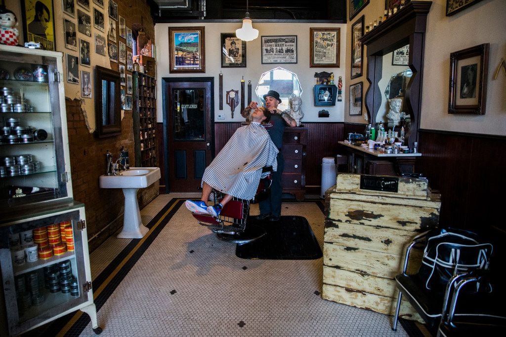 Barber Rob Villarreal, right, gives a hair cut to Andrew Pratt at Rob's Chop Shop across the street from Fair Park on Friday, January 20, 2017 on Parry Avenue in Dallas.