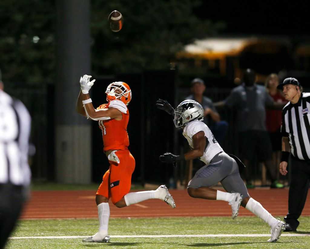 Rockwall's Jaxon Smith-Njigba (11) catches a pass for a touchdown in front of Arlington Martin's Christian Traylor (10) during the first half of play at Wilkerson-Sanders Memorial Stadium in Rockwall, Texas on Friday, September 20, 2019. (Vernon Bryant/The Dallas Morning News)