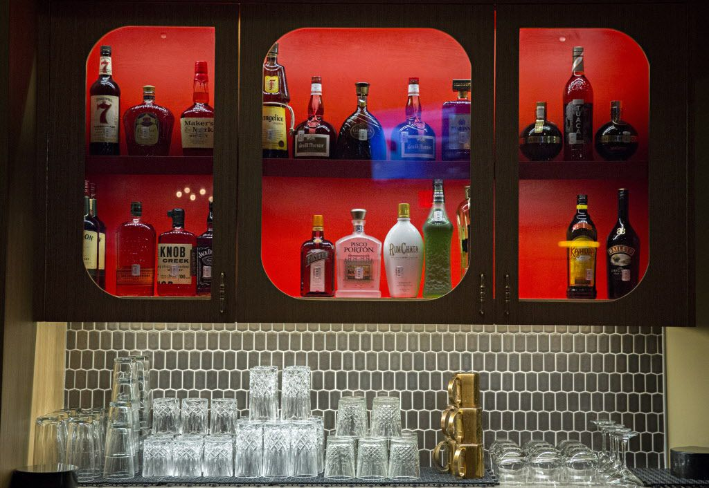 Liquor and serving glasses in the bar at The Royale Magnificent Burgers Thursday, February 18, 2016 in Plano, Texas. (G.J. McCarthy/The Dallas Morning News)