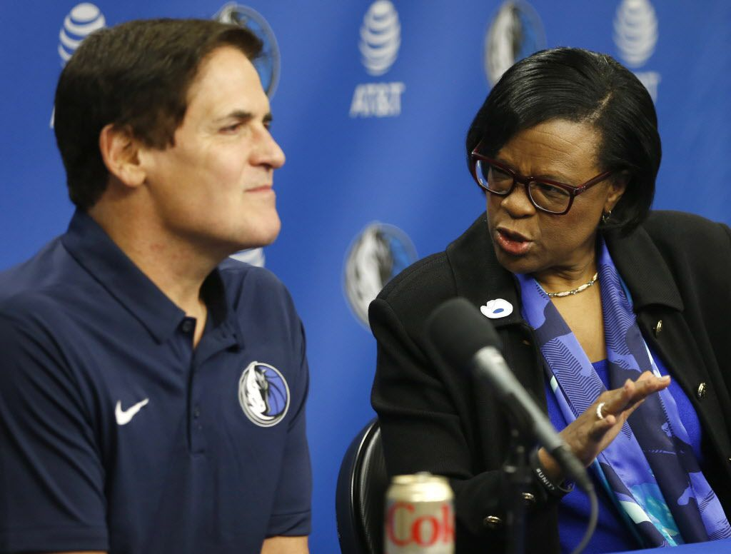 Dallas Mavericks interim CEO Cynthia Marshall advises Dallas Mavericks owner Mark Cuban on an answer as questions are asked about prior knowledge of recent events during a press conference at American Airlines Center in Dallas on Monday, February 26, 2018. Marshall has been hired by the Mavericks to help clean up after the recent sexual assault scandal in the front office. (Vernon Bryant/The Dallas Morning News)