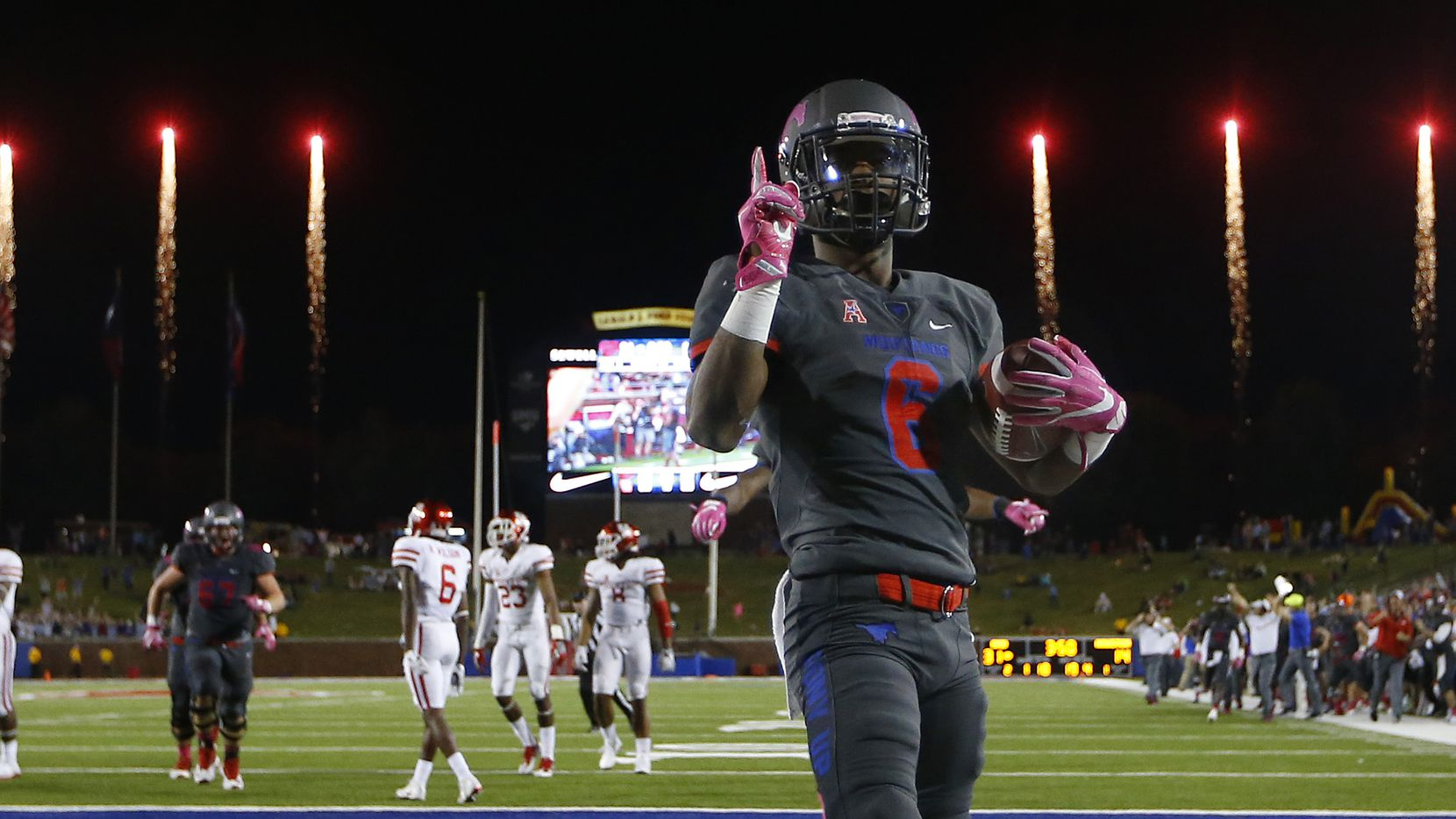FILE - SMU running back Braeden West (6) scores the final touchdown in the fourth quarter as fireworks go off at Gerald J. Ford Stadium in University Park on Saturday, Oct. 22, 2016. SMU upset Houston 38-16.  (Tom Fox/The Dallas Morning News)