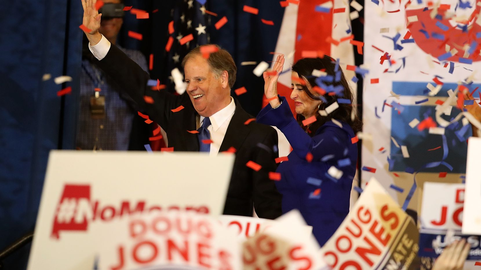 Doug Jones, with his wife, Louise, celebrated his victory in Birmingham, Ala., Tuesday night.