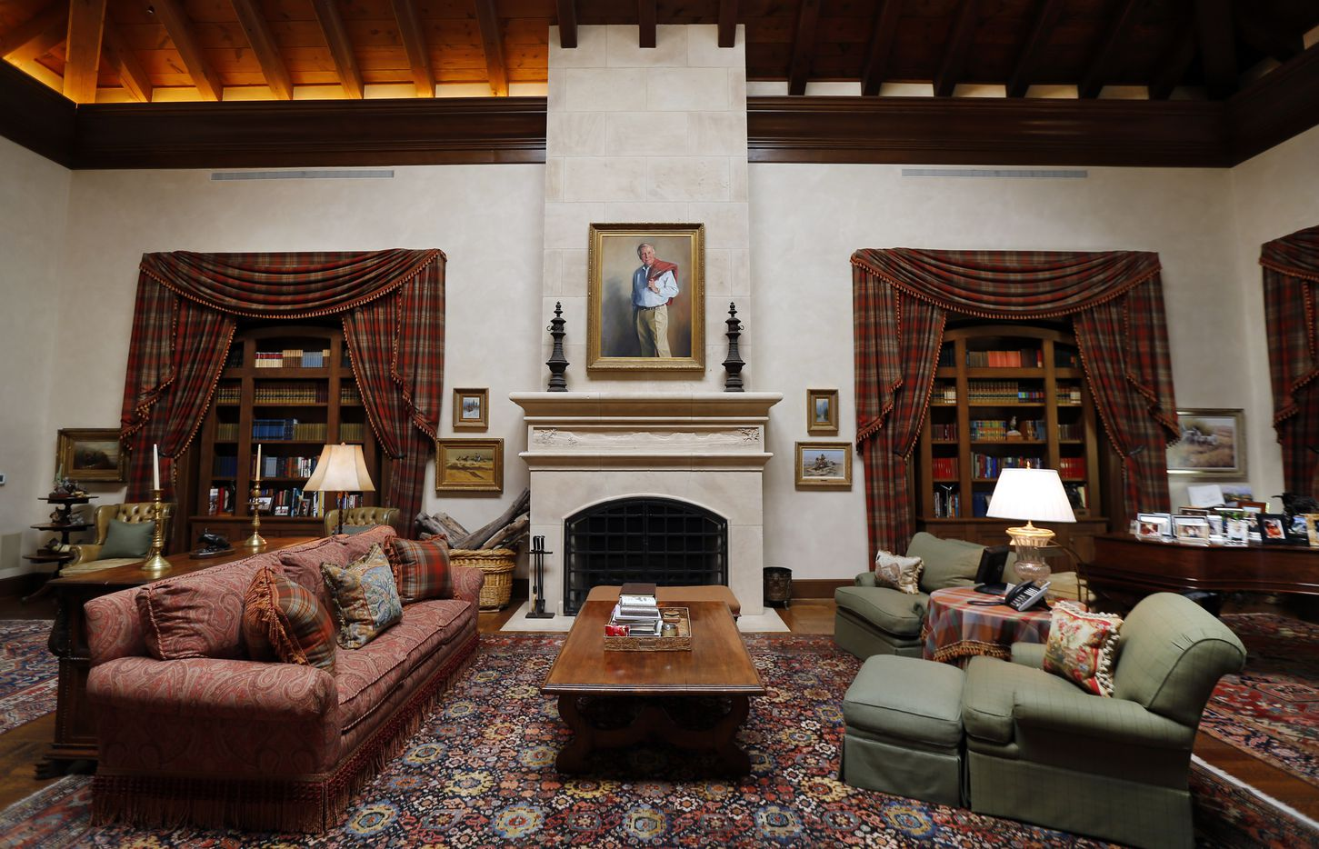 The great room in the lodge has a portrait of businessman T. Boone Pickens hanging above the fireplace.