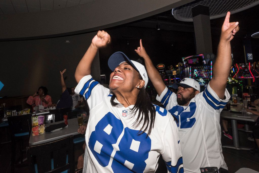 Donna Cotton and her husband, Brad Cotton, celebrated a Dallas Cowboys touchdown as they  watched the team's season opener against the New York Giants at Dave & Buster's in Dallas. (Rex C. Curry/Special Contributor)