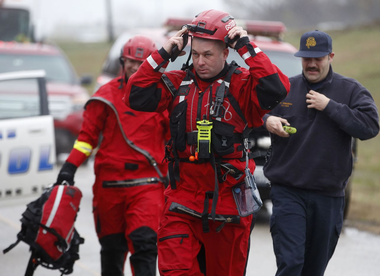 Dallas Fire-Rescue teams respond to a report that a car was swept away Wednesday.
