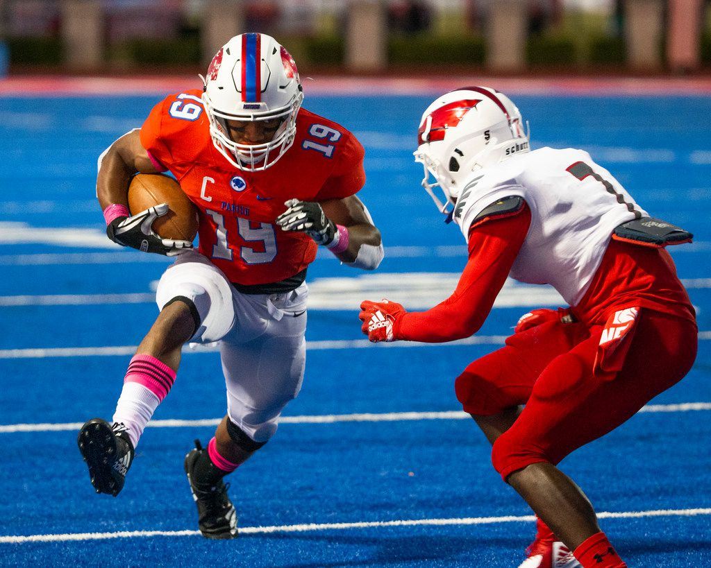 Parish Episcopal wide receiver Kaleb Culp (19) rushes for yards against Bishop Dunne defensive back Kendall Newsom (7) during the football game between Parish Episcopal High School and Bishop Dunne Catholic School at the Gloria H. Snyder Stadium in Farmers Branch, Texas, on Friday, Oct. 11, 2019. (Lynda M. Gonzalez/The Dallas Morning News)
