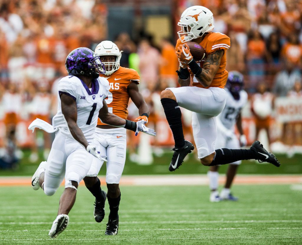 Texas Longhorns defensive back Caden Sterns (7) intercepts a pass intended for TCU Horned Frogs wide receiver Jalen Reagor (1) during the second quarter during a college football game between TCU and the University of Texas on Saturday, September 22, 2018 at Darrell K Royal - Texas Memorial Stadium in Austin. (Ashley Landis/The Dallas Morning News)