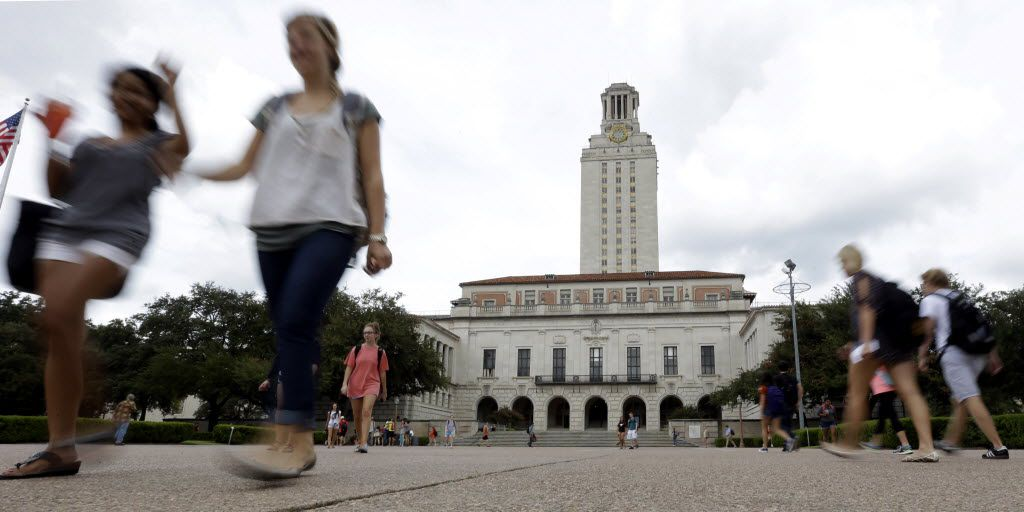 FILE - In this Sept. 27, 2012 file photo, students walk through the University of Texas at Austin campus near the school's iconic tower in Austin, Texas. The cost of funding higher education for veterans has increased sevenfold since Texas legislators allowed veterans to pass the benefit onto a child. (AP Photo/Eric Gay, File) 04232015xNEWS 07012015xALDIA